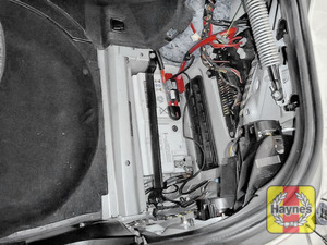 Illustration of step: Open the battery cover, the battery is located in the boot of this vehicle - step 1