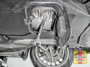 Illustration of step: With an oil catchment tray in position, use a 17mm spanner or socket to carefully remove the sump plug and fully drain the oil - step 7