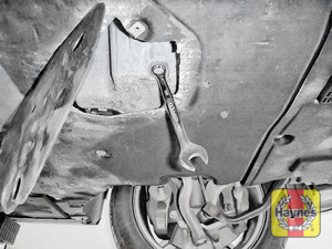 Illustration of step: Using a 17mm spanner or socket, carefully remove the sump plug and fully drain the oil - step 7
