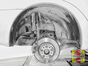 Illustration of step: As with the fronts, check for wear in the rear wheel hub bearings by grasping the wheel and trying to rock it - step 9