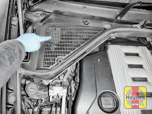 Illustration of step: The brake fluid reservoir is under this plastic moulding - step 1