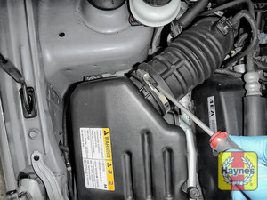 Illustration of step: Undo circular clip on the air intake - use a 7mm socket or a screwdriver to do this - step 2