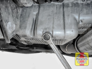 Illustration of step: Using a 17mm spanner or socket, carefully remove the sump plug and fully drain the oil - step 3