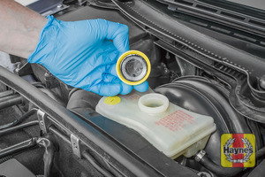 Illustration of step: If the level needs topping up - WEARING GLOVES - carefully open the cap, and have a paper towel ready to catch any drips because brake fluid is corrosive - step 2