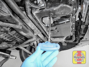 Illustration of step: With a oil catchment tray in position, use an 8mm Allen key to carefully remove the sump plug and fully drain the oil - step 6