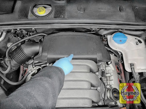 Illustration of step: The location of oil filter is under this engine cover - step 1