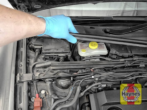 Illustration of step: You will need to lift the plastic cover to access the brake fluid reservior - step 5