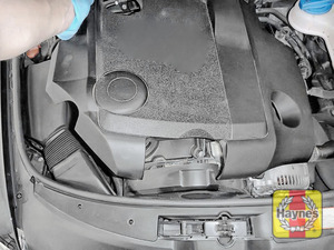 Illustration of step: Remove the engine cover to access the oil filter cartridge - step 1