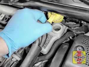Illustration of step: If the level needs topping up - WEARING GLOVES - carefully open the cap, have a paper towel ready to catch any drips as brake fluid is corrosive - step 6