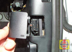 Illustration of step: Unclip the cover on the driver side pillar trim, and connect a fault code reader into the 16-pin diagnostic socket - step 2