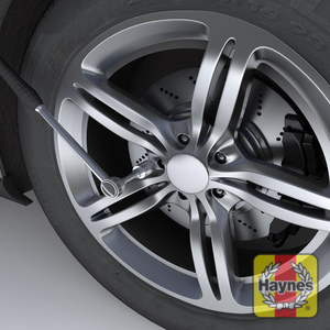 Illustration of step: ALWAYS loosen the wheel nuts BEFORE jacking the car ! Quarter to half turn, anticlockwise is plenty to loosen the wheel nuts - step 1
