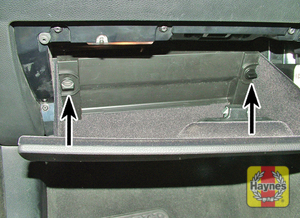 Illustration of step: Open the glovebox, rotate the fasteners anti-clockwise and fold-down the fusebox cover - step 1
