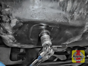 Illustration of step: With an oil catchment tray in position, use an 8mm allen key socket to carefully remove the sump plug and fully drain the oil - step 5
