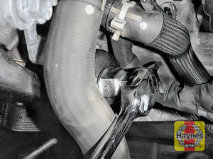 Illustration of step: Using a 24mm socket, fit the tool securely onto the oil filter housing - step 3