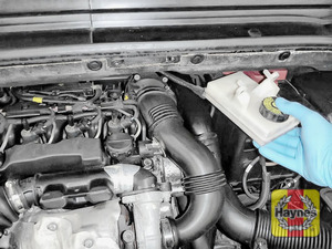 Illustration of step: Carefully relocate the brake fluid reservoir to gain access - step 4
