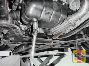 Illustration of step: Using a 21mm spanner or socket, carefully remove the sump plug and fully drain the oil - step 5