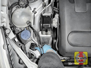 Illustration of step: The power steering fluid reservoir is located here - step 4