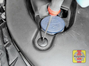 Illustration of step: Undo two clips - using a screwdriver - press insert down to release the clip  - step 2