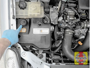 Illustration of step: The power steering fluid reservoir is located here - step 2