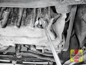 Illustration of step: Using an 8mm Allen key, carefully remove the sump plug and fully drain the oil - step 5
