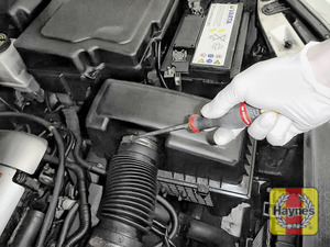 Illustration of step: Undo the circular clip on the air intake - use a 7mm socket or a Phillips screwdriver - step 2