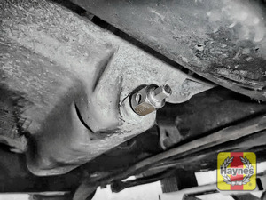 Illustration of step: Using an 8mm Allen key socket, carefully remove the sump plug and fully drain the oil - step 3