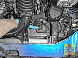 Illustration of step: The power steering fluid reservoir is located here - always wear gloves - step 1