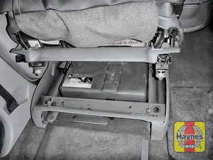 Illustration of step: Replace battery cover and lower the seat - step 7