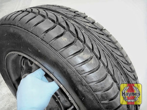 Illustration of step: Before refitting the wheels, take a look at the tyre tread, there is a UK legal requirement to have a minimum of 1 - step 13