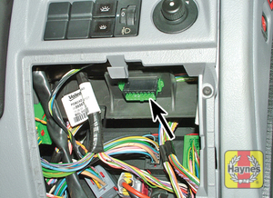 Illustration of step: Unclip the panel from the driver's side of the fascia to access the diagnostic socket - step 2