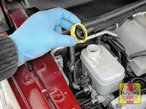 Illustration of step: If the level needs topping up - WEARING GLOVES - carefully open the cap, and have a paper towel ready to catch any drips as brake fluid is corrosive - step 3