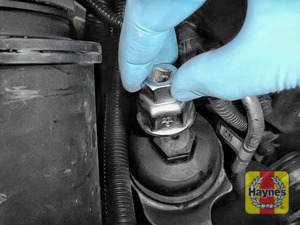 Illustration of step: Fit a 27mm filter wrench socket securely onto the oil filter housing - step 4