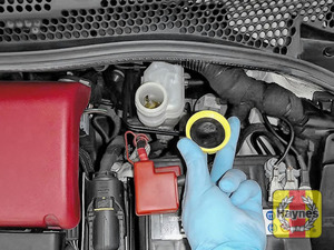 Illustration of step: If the level needs topping up - WEARING GLOVES - Carefully open the cap, have a paper towel ready to catch any drips as brake fluid is corrosive! Now securely replace and tighten cap - step 4
