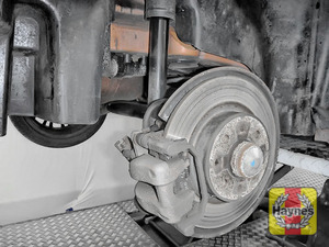 Illustration of step: Take a good look around brake system and the suspension arm, check for any leaks - step 11