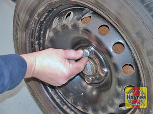 Illustration of step:  Undo the bolts and remove the wheel  - Changing the wheel - step 13