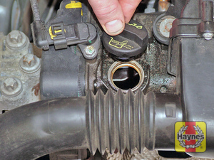 Illustration of step:  Unscrew the oil filler cap  - The correct oil - step 14