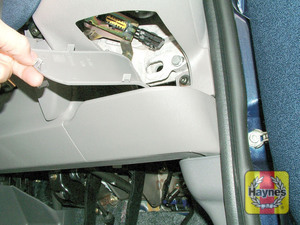Illustration of step: Unclip the panel from the driver's side of the fascia to access the 16-pin diagnostic socket - step 2