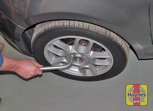 Illustration of step:  Slacken each wheel bolt by a half turn, using the wheel brace - Changing the wheel - step 5