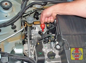 Illustration of step:  The dipstick is located on the right-hand side of the engine (see Underbonnet check points for exact location) - Car care - step 10