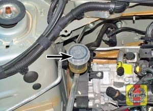 Illustration of step:  On models with a separate clutch fluid reservoir, it's located on the right, or left-hand side of the engine compartment - Safety first! - step 27