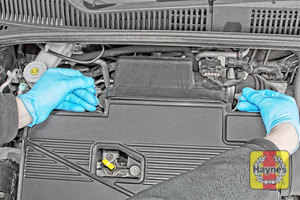 Illustration of step: Undo the two retaining clips on the air filter body - step 2