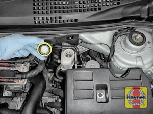 Illustration of step: If the level needs topping up - WEARING GLOVES - carefully open the cap, and have a paper towel ready to catch any drips as brake fluid is corrosive! Now securely replace and tighten cap - step 3