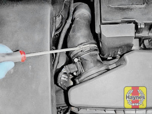 Illustration of step: Firstly, undo circular clip on the air intake – use a 7mm socket or screwdriver - step 2