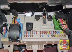 Illustration of step: The main fusebox is located under the passenger's side of the fascia - step 1