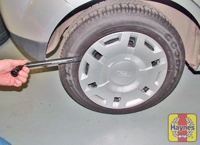 Illustration Of Step Prise Off The Wheel Trim Or Alloy Wheel Centre Cover