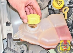 Illustration of step:  If topping-up is necessary, wait until the engine is cold, then turn the pressure cap on the expansion tank slowly anti-clockwise, and pause until any pressure remaining in the system is released - Car Care - step 17
