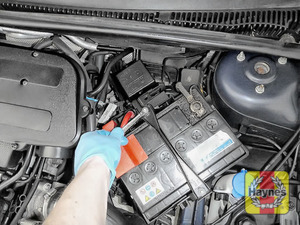 Illustration of step: Check battery is generally secure, if loose, tighten the battery retainer - step 4