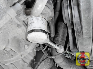 Illustration of step: Using an oil filter wrench, unscrew the filter anticlockwise and remove the old oil filter - step 2