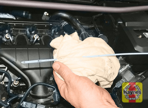 Illustration of step:  The dipstick is located at the front of the engine (see Underbonnet check points for exact location) - Car care - step 10