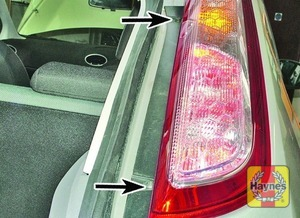 Illustration of step: 1 1 Open the tailgate, and undo the two light unit retaining bolts (arrows)  - Hatchback - step 1
